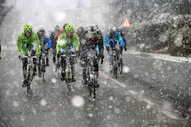 Photoraph by Graham Watson. The peloton races through a snowstorm in the 2013 Milan San Remo